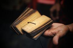 Heritage. Buddhist monk holds Sanskrit in the hands Stock Photo
