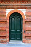 Heritage Arched Door in Red Brick Wall. Heritage Arched Door in Decorative Red Brick Wall.  Adelaide, Australia Royalty Free Stock Images