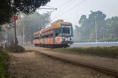 Heritage Calcutta tram a historic mode of transportation at the Kolkata Maidan area on a foggy winter morning. Stock Photo