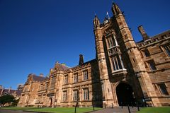 Gothic revival style facade of classic and historic Quadrangle with beige sandstone at University of Sydney, Australia. Heritage and classical school building stock photography