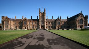 Gothic revival style facade of classic and historic Quadrangle with beige sandstone at University of Sydney, Australia. Heritage and classical school building stock photo