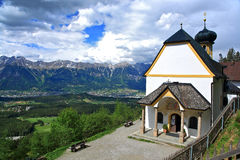 A Heritage House. Small mountain church in Igls. Innsbruck.with alpe mountain as background royalty free stock images