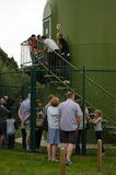 Heritage Open Day visitors, Reading. READING, UK - SEPTEMBER 14, 2014: Visitors enjoying access to the wind turbine in Green Park, Reading as part of the Royalty Free Stock Photo
