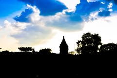 Silhoutte of ruins of ancient royal palace temple in the sunset evening in South East Asia royalty free stock photography
