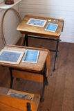 Heritage school desks. Row of heritage school desks with small chalkboards Royalty Free Stock Images