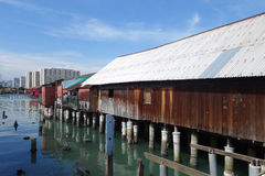 Heritage stilt houses of the Chew Clan Jetty in Penang, Malaysia. PENANG, MALAYSIA-29 DECEMBER, 2016: Heritage stilt houses of the Chew Clan Jetty, George Town Royalty Free Stock Image