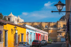 Heritage Street in Antigua, Guatemala. Sunny afternoon on the main street in Antigua Guatemala with colorful heritage houses. At the end of the perspective, we stock photos