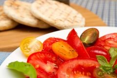 Heritage tomatoe salad with flat breads Stock Image