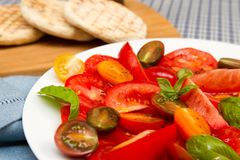 Heritage tomatoe salad with flat breads Stock Photo