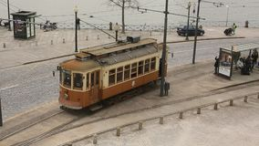 Heritage tram tourist line on the shores of the Douro. PORTO, PORTUGAL - FEB 18, 2015: Heritage tram tourist line on the shores of the Douro. Construction its stock footage