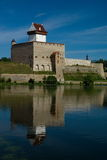 Herman Castle. City of Narva, Estonia. View of Herman Castle with colorful reflection of lights off the water Stock Photos