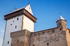 Herman castle facade fragment over blue sky. Narva Stock Image