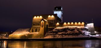 Herman Castle in Narva, Estonia. Russia-Estonian border, Night winter view from Russian side Stock Photo