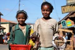 Hermana que vende los cables Foto de archivo