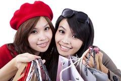 Hermanas de las compras aisladas en el fondo blanco Fotografía de archivo libre de regalías