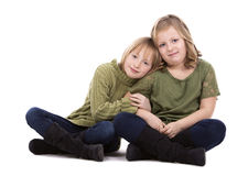 Hermanas en el fondo blanco Foto de archivo libre de regalías
