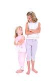 Hermanas hermosas en color de rosa sobre blanco Imagen de archivo libre de regalías