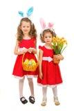 Hermanas hermosas en vestidos rojos Imagenes de archivo