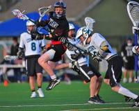 Hermanas HS del lacrosse de los muchachos tiradas en meta Fotografía de archivo libre de regalías