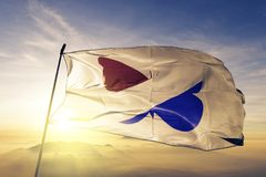 Hermanas Mirabal Province of Dominican Republic flag textile cloth fabric waving on the top sunrise mist fog. Beautiful royalty free stock photography