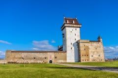 Hermann Castle facade on sunny day, Narva, Estonia. Stock Images