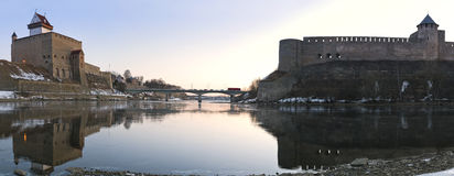 Hermann castle of Narva fortress winter landscape. Hermann castle of Narva and Ivangorod Fortress winter landscape panorama, Estonia and Russia border Stock Photography