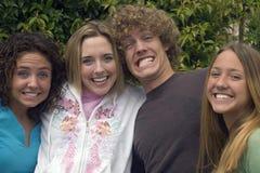 Hermano y hermanas felices imagenes de archivo