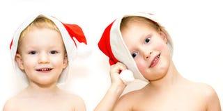 Hermanos en sombreros de la Navidad Fotos de archivo libres de regalías