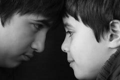 Hermanos ligeros y oscuros Imagen de archivo libre de regalías