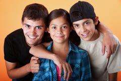 Hermanos que cuidan y su hermana Imágenes de archivo libres de regalías