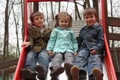 Hermanos y hermana en el patio Fotos de archivo libres de regalías
