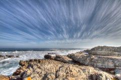 Hermanus, South Africa. Streaked clouds over Hermanus coastline Stock Images