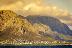 Hermanus At Sunset. Sunset clouds over mountains at Hermanus, South Africa Royalty Free Stock Photos