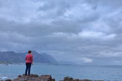 Come on whale show me your face. Hermanus is a very popular destination for whale watching in South Africa during spring. My wife is keeping an eye here on the royalty free stock images