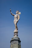 Hermes Mercury statue. Statue of Hermes the messenger to Greek Gods carrying his golden staff entwined with snakes known as a caduceus. The Romans referred to stock photo