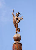 Hermes Mercury statue. Statue of Hermes the messenger to Greek Gods carrying his golden staff entwined with snakes known as a caduceus. The Romans referred to royalty free stock photo