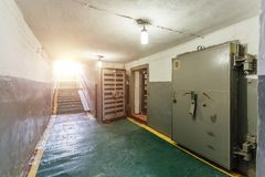 Hermetic metal armored doors with valves in  the entrance of soviet bomb shelter protective construction of civil defense.  Royalty Free Stock Photo