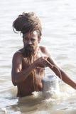 A hermit bathing at Kumbh Mela 2013 Royalty Free Stock Photography