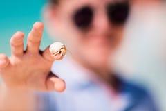 Hermit crab. Close up of hermit crab on kid finger Stock Photo