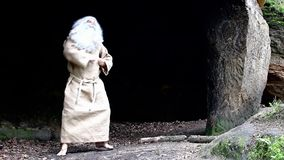 Hermit dancing in a cave stock video footage