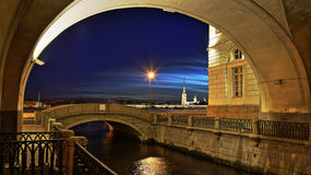 The Hermitage the bridge at night in St. Petersburg. The Hermitage  bridge against the background of the Peter and Paul Fortress at night Royalty Free Stock Images