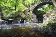 The Hermitage Bridge in Perthshire Scotland with river flowing t Stock Images