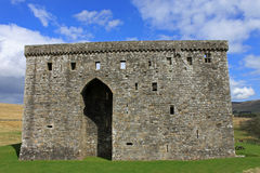 Hermitage castle, Scotland. The  Hermitage Castle in Liddesdale, Scotland, a stronghold constructed around 1360 for defence in the turbulent Scottish Border Stock Photography