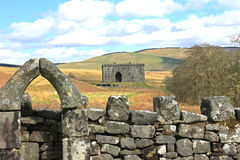 Hermitage castle, Scotland. The  Hermitage Castle in Liddesdale, Scotland, a stronghold constructed around 1360 for defence in the turbulent Scottish Border Royalty Free Stock Photography