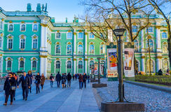 The Hermitage courtyard. Saint Petersburg - April 24, 2015:The tourists going to the entrance to the Hermitage museum through its courtyard, on April 24 in Saint royalty free stock image