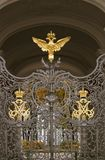 Hermitage museum gates decorated by double-eagle, state symbol of Russia royalty free stock images