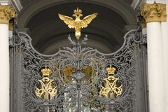 Hermitage museum gates decorated by double-eagle, state symbol of Russia stock photos