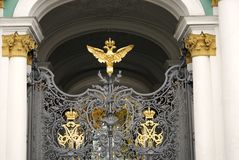 Hermitage museum gates decorated by double-eagle, state symbol of Russia stock photography