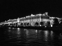 Hermitage museum reflects in Neva river. Winter Palace building, St. Petersburg, Russia. Black and white photo royalty free stock image