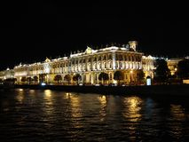 Hermitage museum reflects in Neva river. Winter Palace building, St. Petersburg, Russia Royalty Free Stock Images